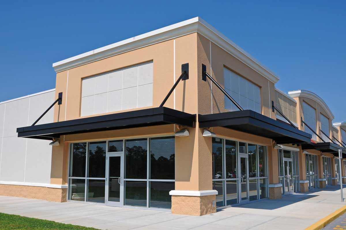 Commercial business office exterior painted desert beige, black & white