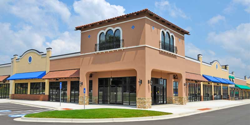 Exterior Commercial Painting - Business building exterior painted desert brown & white