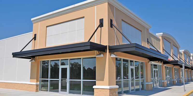 Exterior Commercial Painting - Business office exterior painted desert beige, black & white