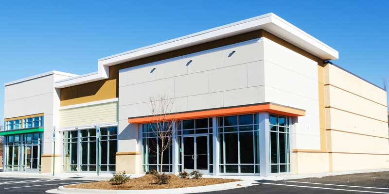 Exterior Commercial Painting - Office building exterior painted tan, white, black, and orange