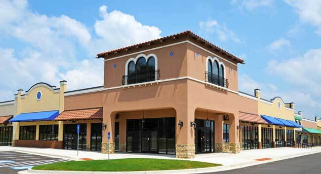 Commercial business building exterior painted desert brown & white