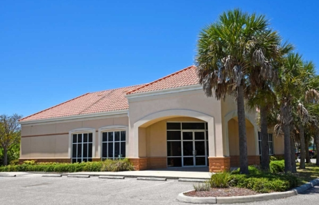Commercial office building exterior painted light tan and white