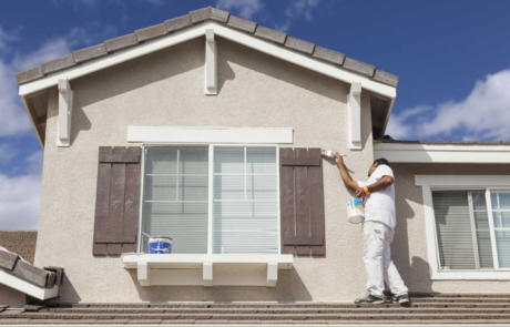 Residential painter painting the exterior of a house