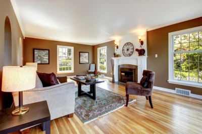 Residential home living room interior painted a tasteful chocolate brown & white