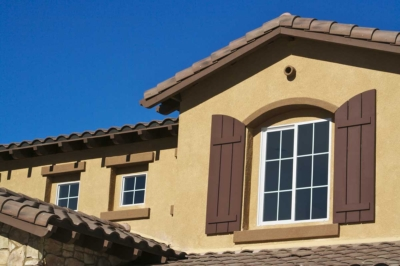 Residential home exterior painted dark tan & brown