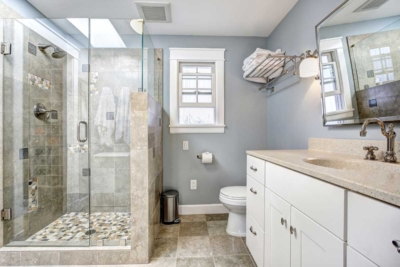 Residential home bathroom interior painted light gray & white