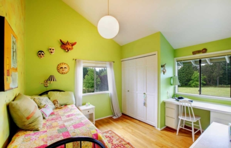 Residential home bedroom interior painted lime green & white