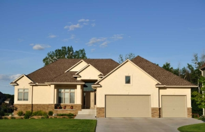 Residential home exterior painted desert sand tan