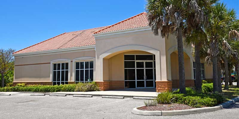 Property Management Painting - Commercial office building exterior painted light tan and white