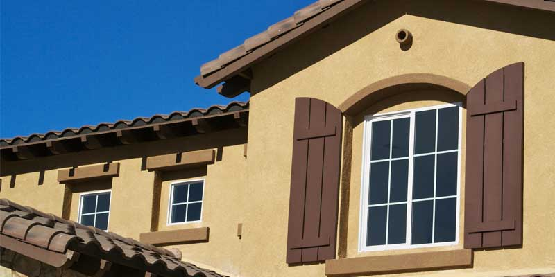Exterior Residential Painting - Home exterior painted dark tan & brown