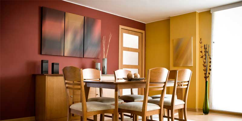 Interior Residential Painting - Dining room interior painted dark red, white, and dark yellow